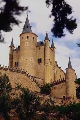 Castle of Alcazar, Segovia, Spain. Like many of Spain's alcazars, or fortified castles, this one at Segovia was first constructed by the Moors sometime in the Middle Ages. It was heavily renovated by the Spanish in the 15th century, and again in the late 19th century.