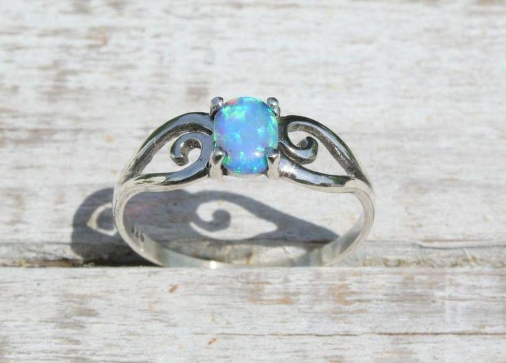 Elegant and feminine Blue opal Sterling Silver ring.