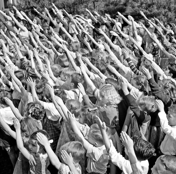 School children in Southington, Connecticut performing the Bellamy salute in May 1942 [This extremely creepy form of patriotic display was abandoned in favor  of the right hand on the heart salute sometime in 1942, when people  realized that the Bellamy salute was a lot like the Nazi salute]