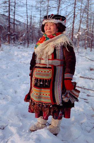 Ulita Elrika, an elderly Even woman from Northern Evensk, wearing traditional dress. Magadan region, E. Siberia, Russia