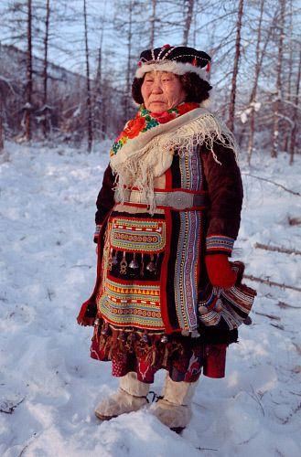 Ulita Elrika, an elderly Even woman from Northern Evensk, wearing traditional dress. Magadan region, E. Siberia, Russia