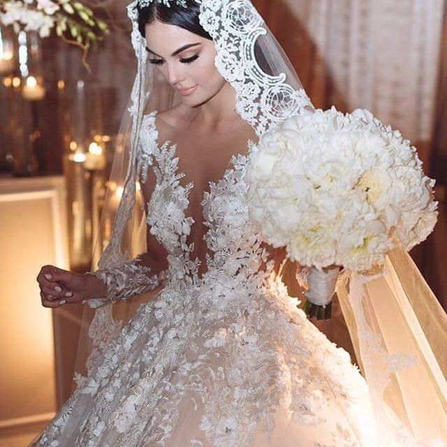 We don't know what we love more, Ximena Navarrete glamorous BENITO SANTOS NOVIAS gown or her oversized #bouquet!   Ximena Navarrete   WedLuxe Magazine   #WedLuxe #Wedding #luxury #weddinginspiration #luxurywedding #whitewedding #couture #weddingdress #weddinggown #bridal #tulle #lace