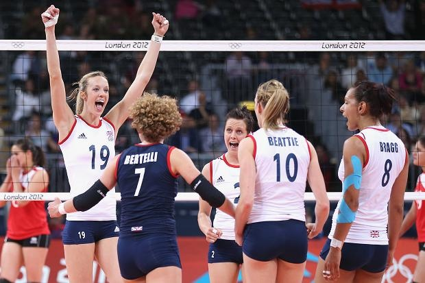 Team GB volleyball players celebrate winning the fourth set against Algeria