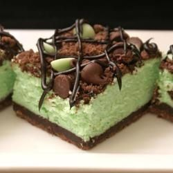 """St. Patrick's Chocolate & Mint Cheesecake Bars - Another pinner says: """"It was very yummy. Loved the crust. Smells wonderful baking,! I would suggest letting them completely chill over night before eating because it made a huge difference in the taste and then we couldn't stop eating them!! A real crowd-pleaser!"""""""
