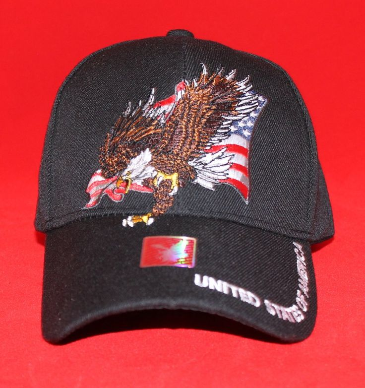 """USA Flag and Bald Eagle Velcro Cap    The USA Flag and Bald Eagle Velcro Cap features a solid color background. The crown of the cap features an embroidered American flag as the background of the design. Then a bald eagle with wings stretched out in flight is embroidered on top of the flag. The bill of the cap is curved. Embroidered on the bill of the cap is """"United States of America. The back features an adjustable Velcro strap for comfort.  10% of all proceeds from this cap go to the W..."""