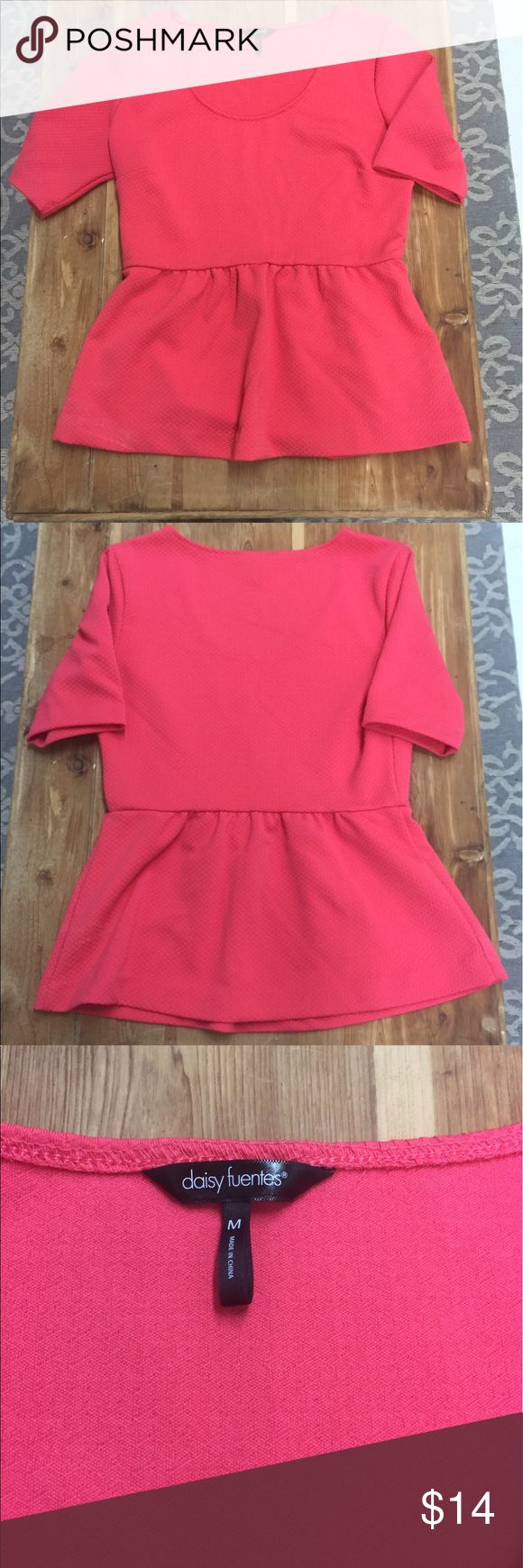 Pink peplum top Perfect pink peplum top!! Great for the office or paired with jeans or pants for a night out! Daisy Fuentes Tops