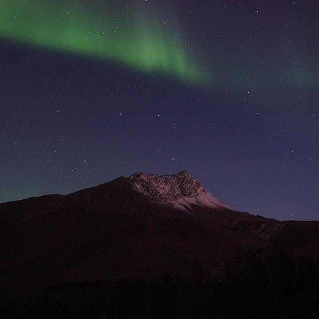 The Aurora over a snow capped mountain near Atigun Pass.... #alaska #aurora #northernlights #sometimesiwander #lifeoutside