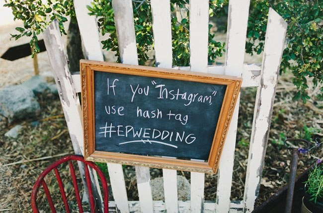 Fun tip for your wedding day: have a hashtag for your wedding so you can go back and see all the postings on twitter and instagram! Example: #crabbwedding. (Photo Credit: Hugh Forte via Green Wedding Shoes)