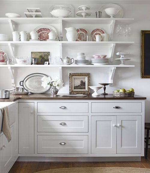 Crisp white kitchen with open shelving display: