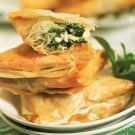Spanakopita - Common all over Greece, stuffed filo pastries make a memorable meze, or appetizer. These small triangles are stuffed with feta and spinach. You might also see them stuffed with feta and herbs, or with lamb and spices and rolled into cigar shapes or tied like knots. http://www.williams-sonoma.com/recipe/spanakopita.html