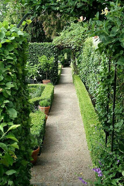 Co Co's Collection: This formal garden elevates a small space
