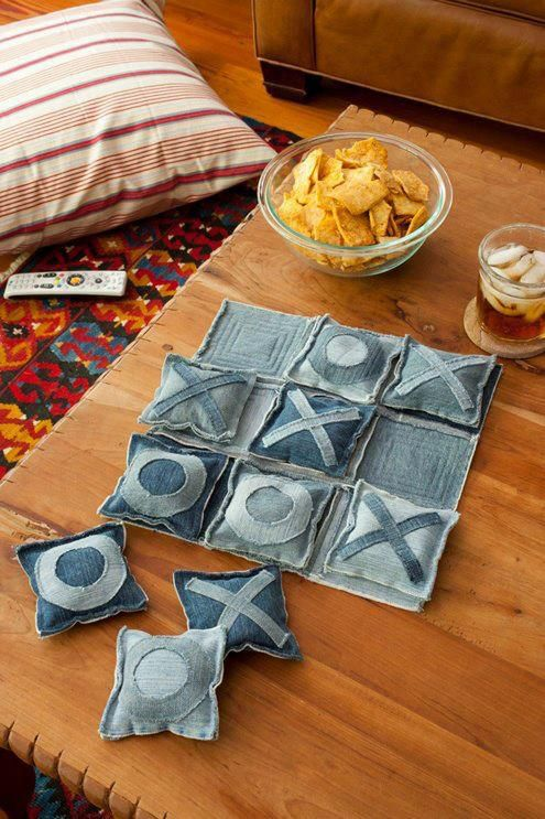 "Use old jeans, cut into squares, add some batting material to the center, sew edges together. Either sew or draw the ""X"" and ""O"" onto them and instant tic tac toe game for kids! (Use Dad's jeans.)"
