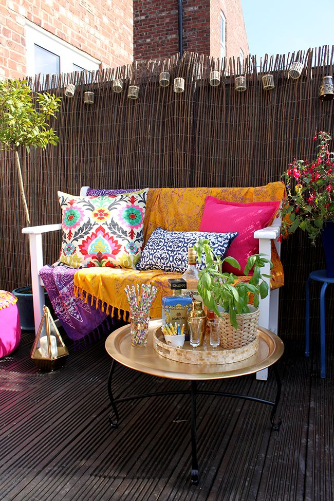 Eclectic Boho Glam Garden Reveal - Swoon Worthy - Boho textiles on white bench