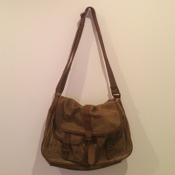 Brown canvas and leather messenger bag Casual masculine messenger bag. I've used it as a lap top bag for a while! Can carry a lot of stuff. Good condition! Topman  Bags Travel Bags