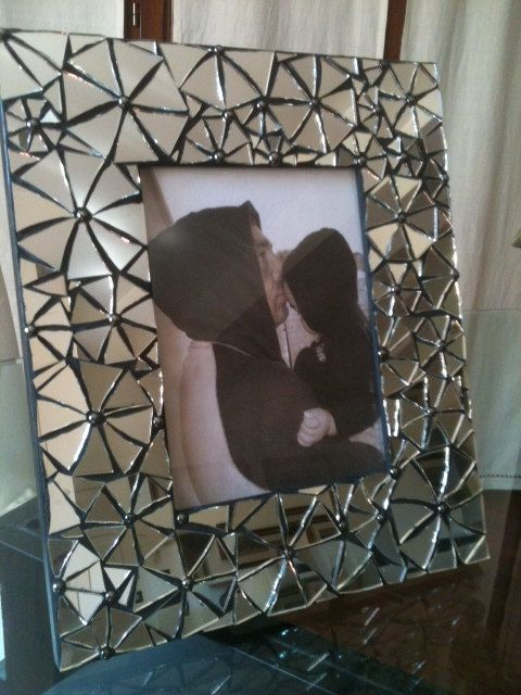 This big mosaic frame has been made with mirrors and cabochons. On request it can be added a mirror inside.