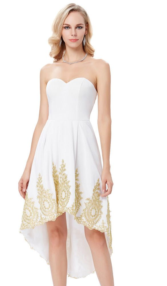White evening dress with golden embroidery