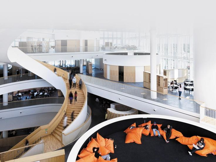 """Ørestad College in Copenhagen is not your average school. Its vast open space with multiple overlapping layers creates a variety of nooks and crannies, making it easier for pupils to find their own way of working and to collaborate with peers. """"They can be inspired by each other as well as by the teachers,"""" says Kim Herforth Nielsen, founding partner of 3XN, the architecture firm that designed the school."""