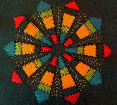 Dresden plate quilt block by JeriSew. She alternated wool felt with embroidered wedges.