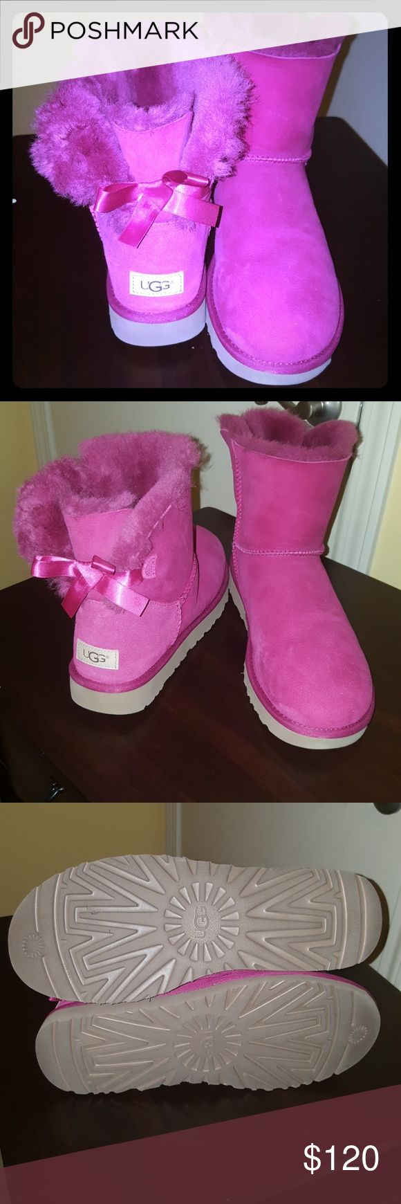 HOT PINK UGGS SIZE 11 GREAT CONDITION! Hot pink ugg boots with bows on the back. Worn once!  Great condition! No weathering on the shoes  or soles UGG Shoes Ankle Boots & Booties