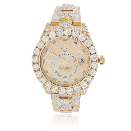 161 SOLD Brand : Rolex Model : Sky-Dweller Materials : 18k Yellow Gold Stone Type : White Round Diamonds Carat Weight : 40CTW Clarity : SI Color : G-H Movement : Perpetual, Mechanical, Self-winding (A