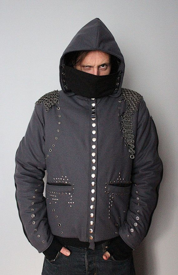 A mens winter jacket with detachable assassins mask, detachable chainmail pieces and decorative zips on sleeves.  Fully handcrafted. One of a kind; the only one in the world like it. As unique as you!!! Made from wool and eco leather & polyester lining.  Chest: up to 105 cm (43) Length: 75 cm (29,5)  FREE SHIPPING WORLDWIDE
