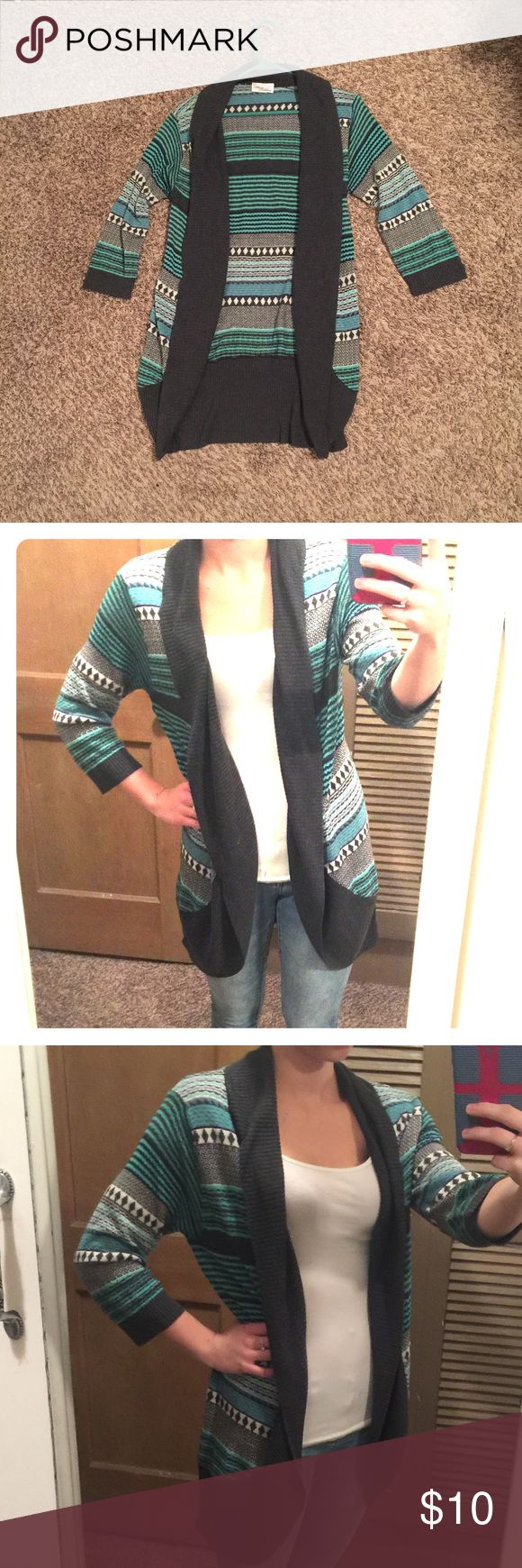 Half-sleeve tribal print cardigan! Tribal print cardigan that is half sleeve. Looks cute with leggings & boots. Very comfortable! There is a normal tag on it but I couldn't find the size, it fits like a medium-large (I'm size small and wearing it in the second two pictures!) H&M Sweaters Cardigans