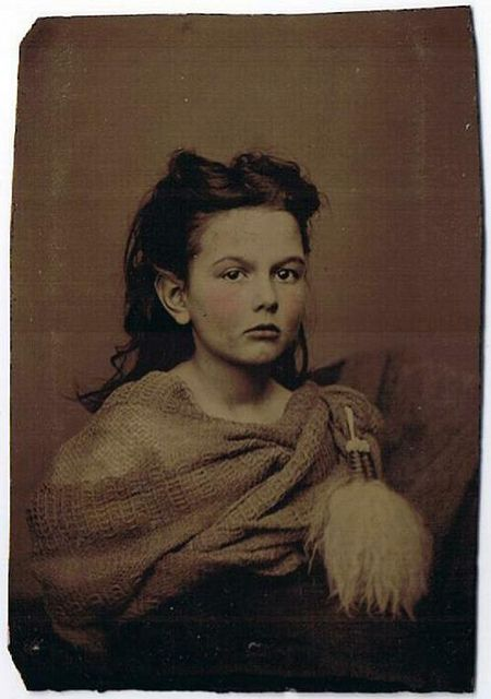 "Original sixth plate (2.5 by 3.75"") tinted tintype of a young lady identified in a family album as Ida Latimer of Rock Cross, Ohio, USA. Photographer and date unknown (probably taken during or around the Civil War era)."