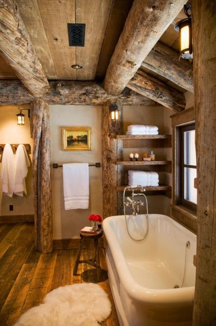 The bathroom is complete with wooden timbers and a western decor
