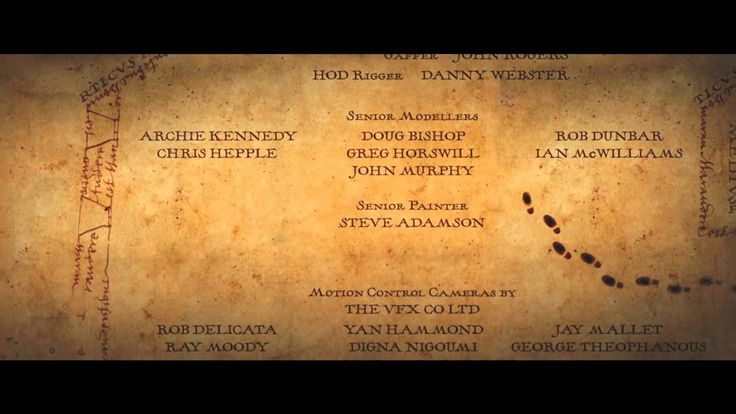Harry Potter and the Prisoner of Azkaban exit credits (2004).  Unfortunatly I couldn't find a full version online, this clip only serves to highlight a couple of naughty footprints in a quiet corner.