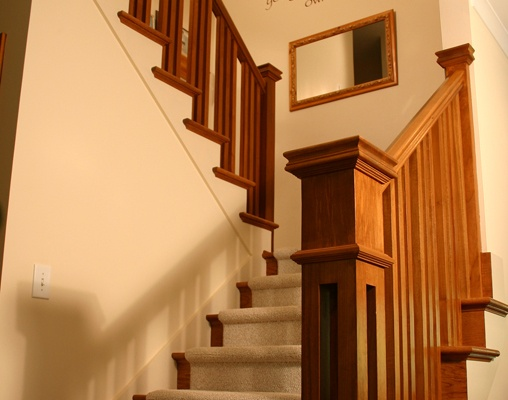 This custom newel and balusters are great finishing touches in this Prairie-Style remodel……….Learn more about how better design makes your home a more fulfilling place to live on our blog at www.rtastudio.blogspot.com