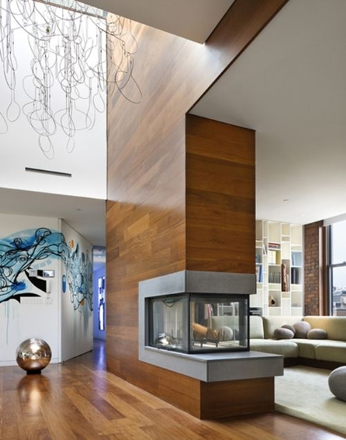 Un beau foyer de style contemporain ou #moderne au salon ou salle de séjour // Beautiful #contemporary #fireplace in open in the living room !