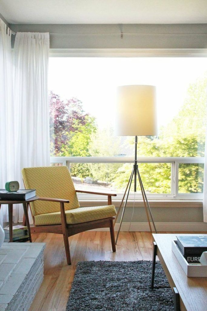 Bright living room corner and yellow midcentury chair | @Melody Patton