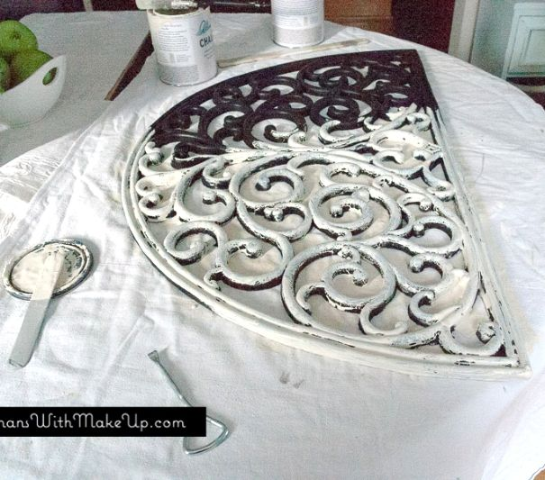 Upcycled rubber door mat. Turned into beautiful hanging scrollwork