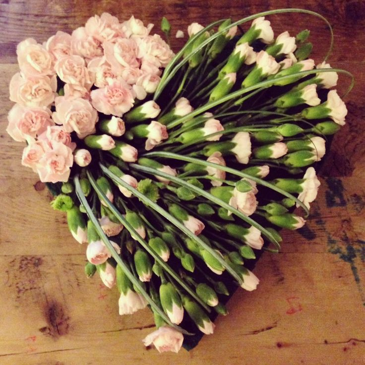 any flowers of choice would be lovely...White ....love this...This says:   Carnation heart