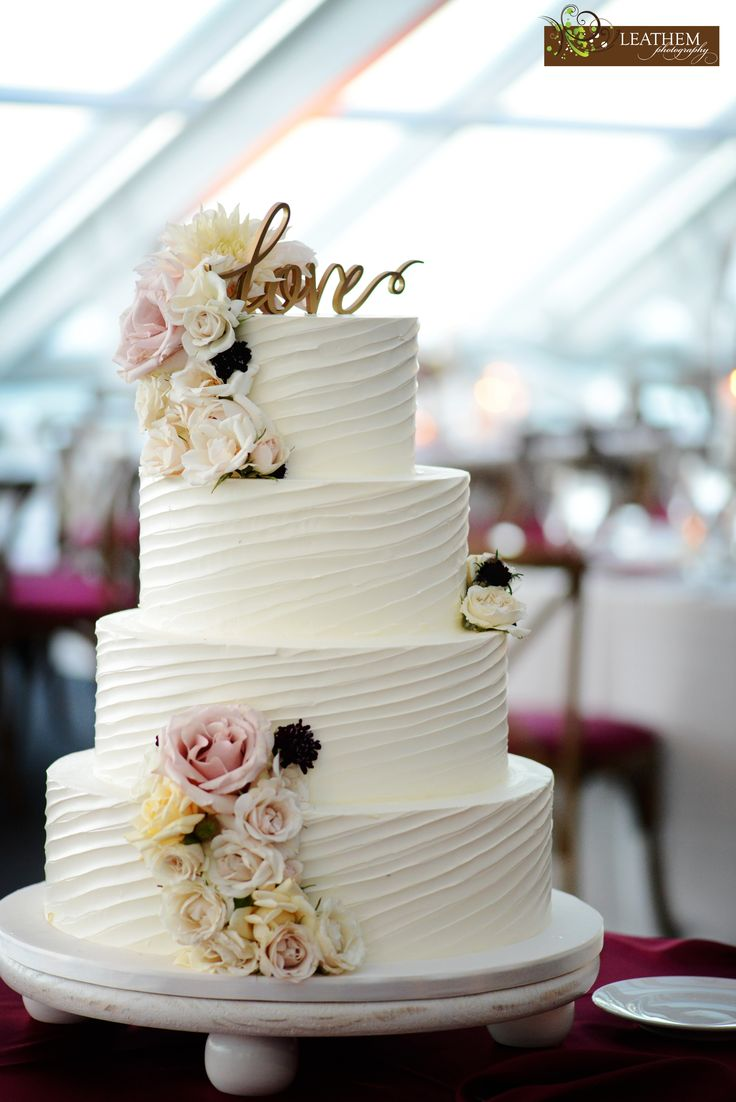 Gorgeous textured buttercream wedding cake adorned with fresh floral.  Photo by Tammy Leathem at @leathemphotography