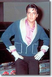 yes, Elvis CAN make this blue coat with sheepskin trim AND white gloves look cool.  Maybe?  from - Presley Photos - 1960s