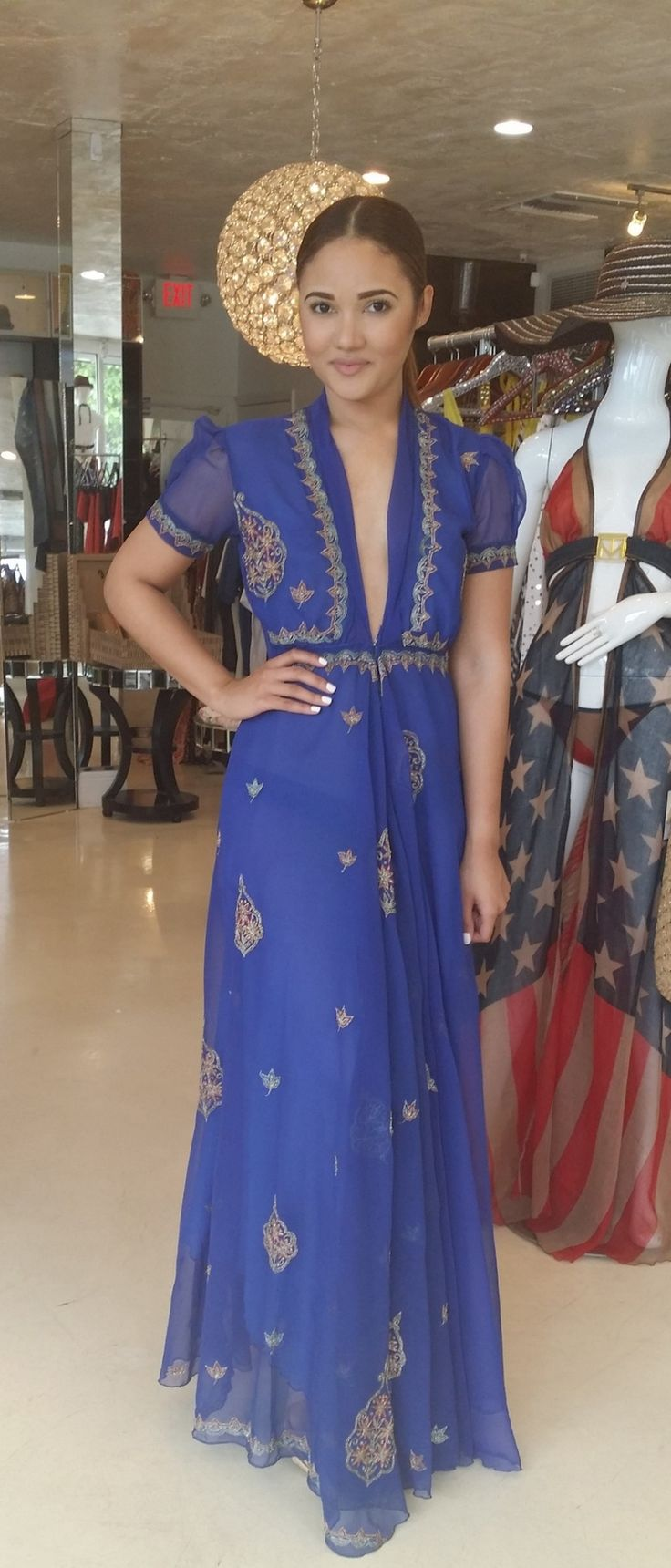 Embroidered Saree Dress 995.00 A deep blue, hand embroidered saree dress with gold floral stitching.  Available in standard sizes or custom tailored using our TM Custom Experience Form at check out. Please allow 2 additional weeks (plus shipping) to tailor this item to your measurements. www.tanyamariedesign.com