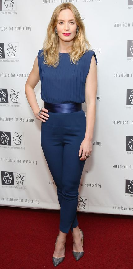 Emily Blunt in a navy ensemble