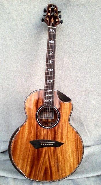 JJ Monkeypod acoustic guitar made by luthier Jeffrey Yong from Malaysia.  Jeffrey Yong Guitars. 32 Jalan 3, Pandan Indah Industrial Park, Kuala Lumpur 55100 Malaysia. http://www.jeffreyyong.com/
