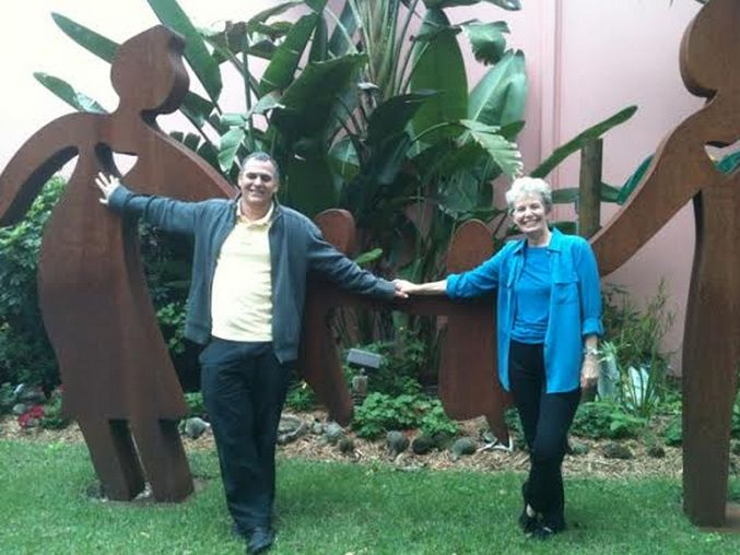 """Professor Ori Lahav with former Sarasota Sister Cities President Linda Rosenbluth  at Museum of Whimsey in Sarasota among the """"hands of friendship"""" sculpture. Prof Lahav represented Tel Mond, Israel as a conference speaker.  Tel Mond is a Sister City of Sarasota."""