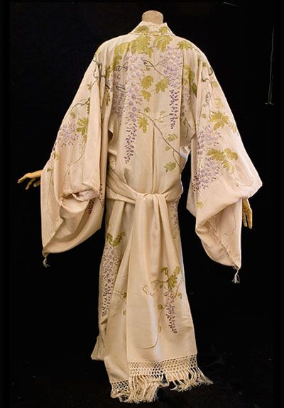Kimono-style tea gown, c.1905 Elegant tea gowns were worn by society ladies in their homes before dinner. They could relax with loosened corsets hidden under the flowing designs. When Orientalism swept the fashion world, loose Eastern garments were adapted to be worn as tea gowns. Many were imported and sold by Liberty & Co. in London. Oriental garments for the Western market are eagerly sought today by collectors as evening wear. This fine piece was made from Japanese fabric, probably in a Tokyo kimono shop for export to the West. The style was adapted for Western tastes, while retaining traditional Chinese sleeves. The sash is more like a scarf than an obi. Without the traditional padding, the gown is lightweight.: Edwardian, 1900S, Inspiration, Gowns, Costume, Kimono Style Tea, Kimono Tea, Kimonos