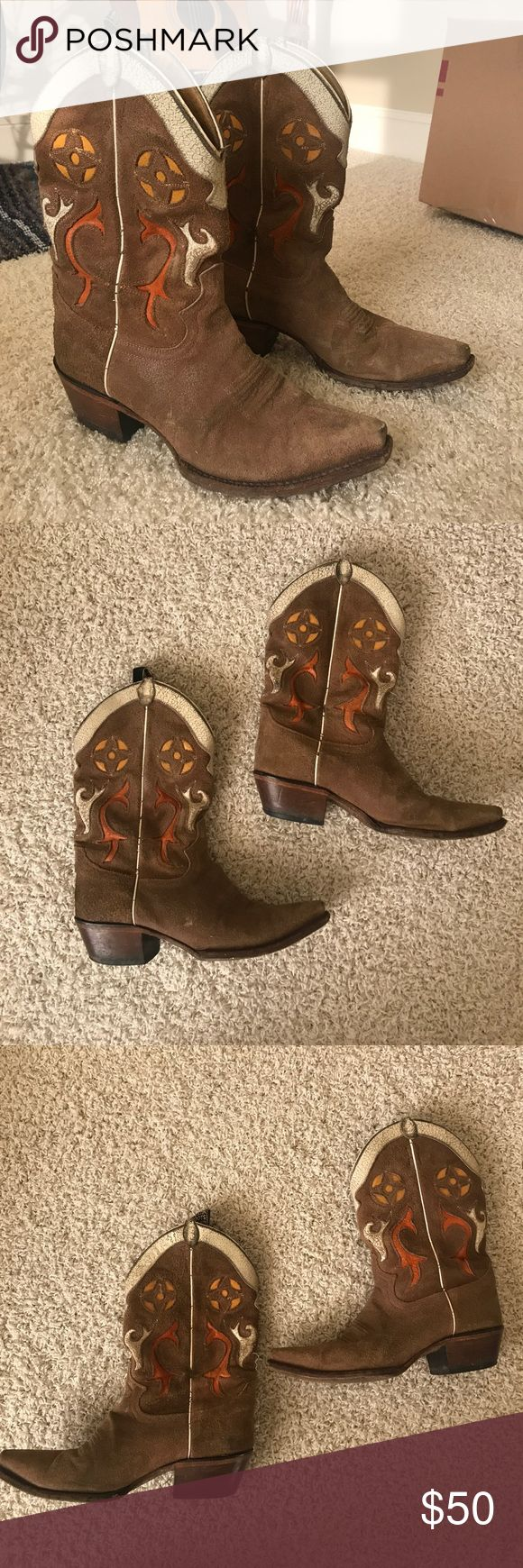 Justin's Cowboy Boots - women's 8 Leather A pair of well loved, but well taken care of cowboy boots from Justin's. These are ready to be re-heeled, which is typically $20 at any shoe or boot store. These were worn to many University of Texas home games… The inlay of the design is a burnt orange color, white, and a mustard yellow. The crackling of the colored leather is intentional and how they came new. Natural rough (NOT suede) leather. These hold up to wear very well. Originally $300 at…