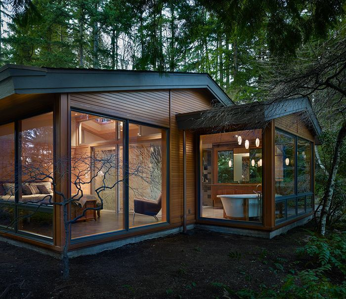 Like a glass pavilion in the forest this renovated 1950's contemporary home is situated on a remote wooded lot in Lake Forest Park, just north of Seattle.