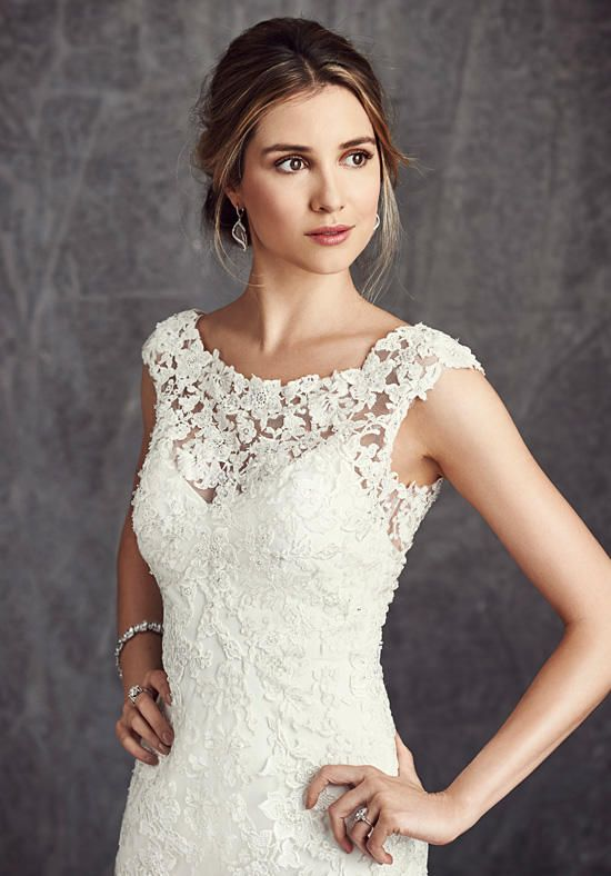 Sheath silhouette with bateau neckline and lace embellishments | Kenneth Winston: Ella Rosa Collection | https://www.theknot.com/fashion/be280-kenneth-winston-ella-rosa-collection-wedding-dress