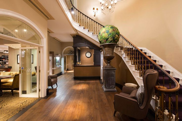 The entrance foyer with bespoke hand finished wooden flooring creates a warm and welcoming feel.  The handmade moss ball creates an original centre piece.