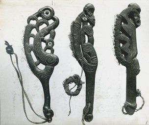 Photograph (black and white), from an album; three Maori carved wooden knives, each edged with shark's teeth. Gelatin silver print