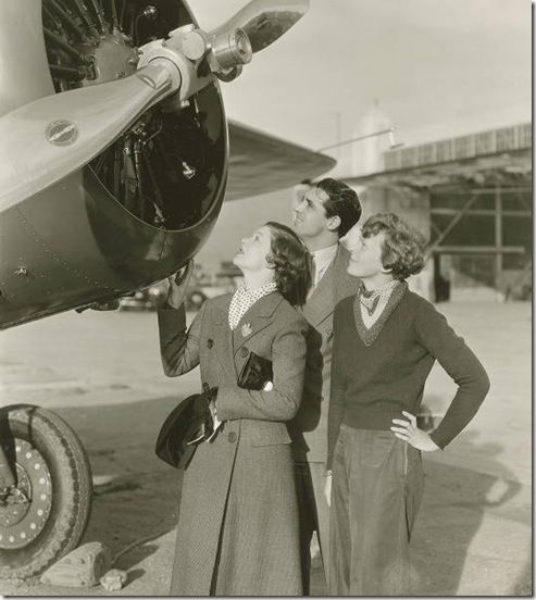 """Cary Grant, Myra Loy, and Amelia Earhart.  Publicity photo for (""""Wings In The Dark"""") starring Myrna Loy, Cary Grant, Dean Jagger in 1935.  Directed by James Flood, produced by Arthur Hornblow Jr.  Cary played Ken Gordon."""