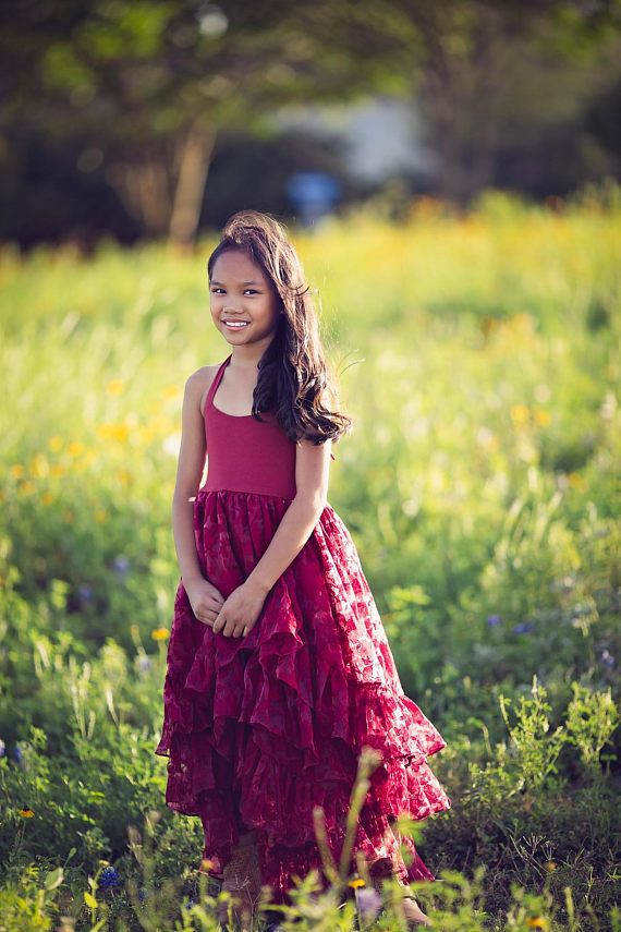 Free shipping on all domestic orders! We ship next business day for orders placed by 6 pm Central Time. THE ARABELLA DRESS IN RUBY RED With layers of ruby red ruffles and a hi-low skirt, this twirly, jewel tone dress is fit for a princess, a beautiful flower girl, a fancy tea party or