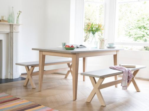 Our Conker kitchen table is an oak frame table with a lovely looking polished concrete top that is actually a tough resin that's wipeable, warm and beautiful.