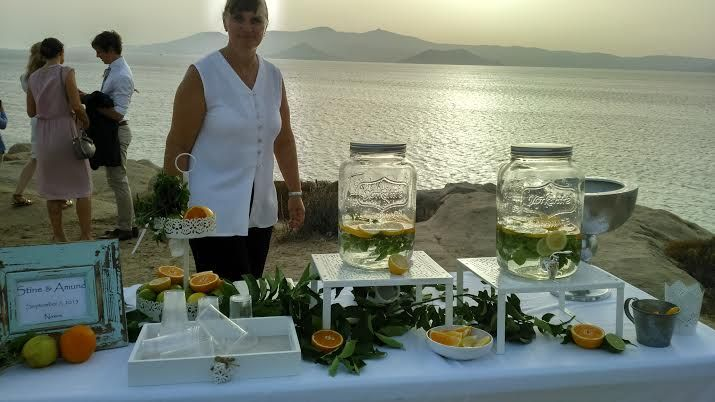 Water for the guests at your wedding to enjoy during sunset - styled by islandevents.gr